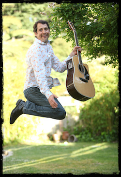 Michael Ryther jumping with guitar
